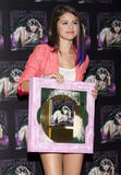 th 63135 SelenaGomezacceptsagoldrecordforheralbumWhenTheSunG 0030 123 92lo Selena Gomez   Receives gold record for When The Sun Goes Down, Four Seasons Hotel, Jan. 26, 2012