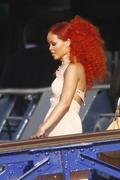 http://img249.imagevenue.com/loc449/th_107886623_RihannaW006_122_449lo.jpg